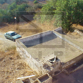 Land with ruin for sale, near the station of Loule.
